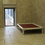 Another view of the Kuranda Bed and door to private patio. Available in Grande and Luxury Rooms.
